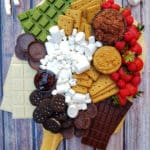 S'Mores charcuterie board arranged on a wooden table top background form the top-down